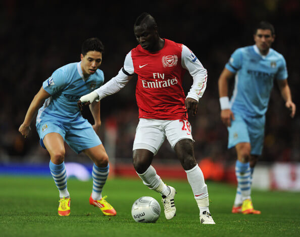 Emmanuel Frimpong of Arsenal is watched by Samir Nasri of Manchester City during the Carling Cup Quarter Final match between Arsenal and Manchester City at Emirates Stadium on November 29, 2011 in London, England.  (Nov. 28, 2011 - Source: Michael Regan/Getty Images Europe)