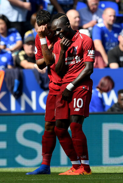 Roberto Firmino of Liverpool celebrates after scoring his team's second goal with Sadio Mane during the Premier League match between Leicester City and Liverpool FC at The King Power Stadium on September 1, 2018 in Leicester, United Kingdom.  (Aug. 31, 2018 - Source: Shaun Botterill/Getty Images Europe)