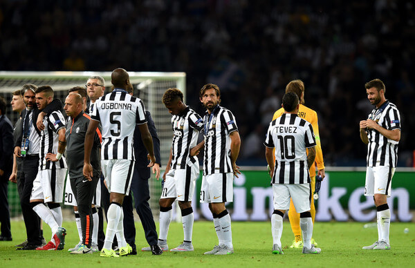 Andrea Pirlo of Juventus looks dejected with team mates after the UEFA Champions League Final between Juventus and FC Barcelona at Olympiastadion on June 6, 2015 in Berlin, Germany.  (June 6, 2015 - Source: Matthias Hangst/Getty Images Europe)