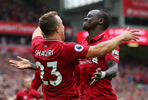 Xherdan Shaqiri of Liverpool celebrates with teammte Sadio Mane after he provides the assist for Liverpool's first goal, an own goal by Wesley Hoedt of Southampton during the Premier League match between Liverpool FC and Southampton FC at Anfield on September 22, 2018 in Liverpool, United Kingdom.  (Sept. 21, 2018 - Source: Alex Livesey/Getty Images Europe)