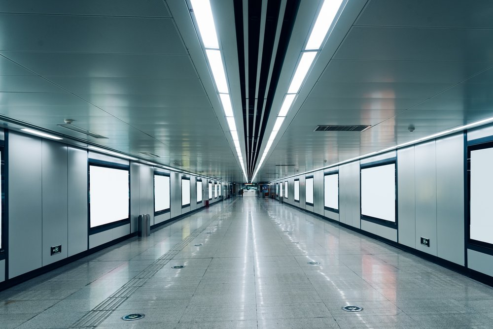 modern-hallway-of-airport-or-subway-station-with-blank-billboards-636850828_8654x5777-squashed.jpeg