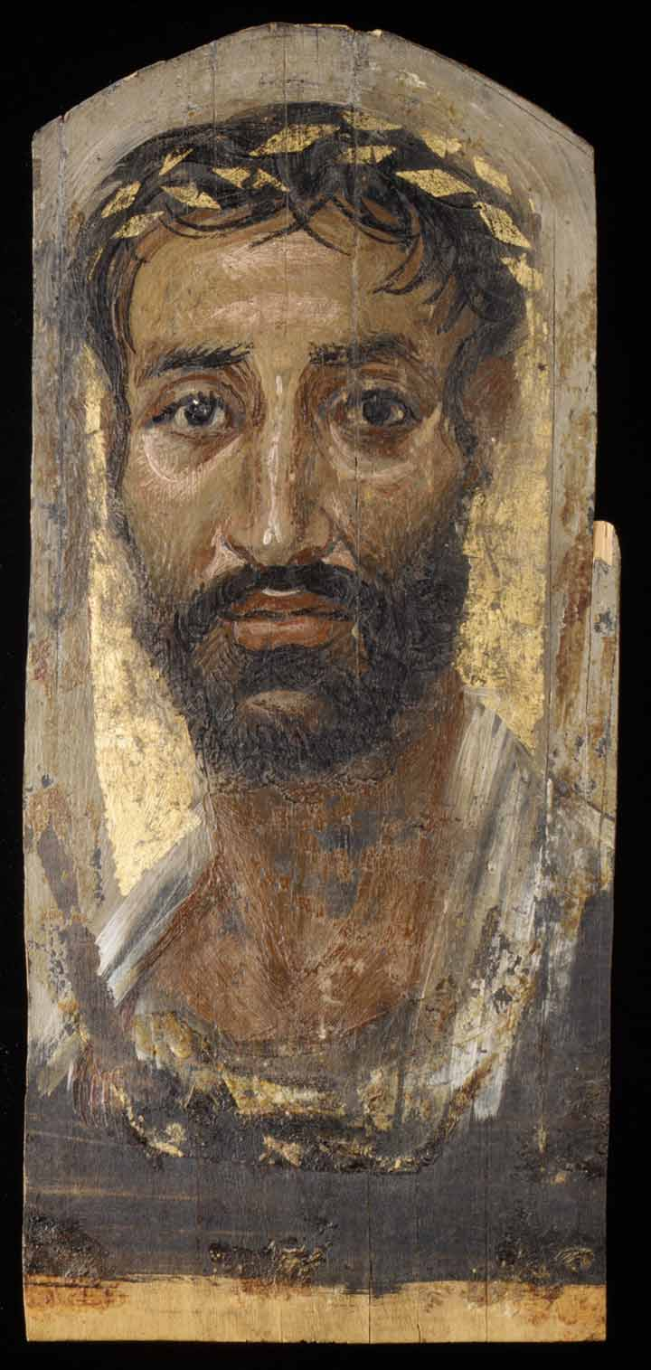 Above:  Portrait of a thin-faced man , 2nd century A.D. Egypt, Roman. Encaustic, limewood, gold leaf, H. 16 5/8 x W. 7 3/8 in. (42.3 x 18.7 cm). The Metropolitan Museum of Art, New York, Rogers Fund, 1909 (09.181.3)