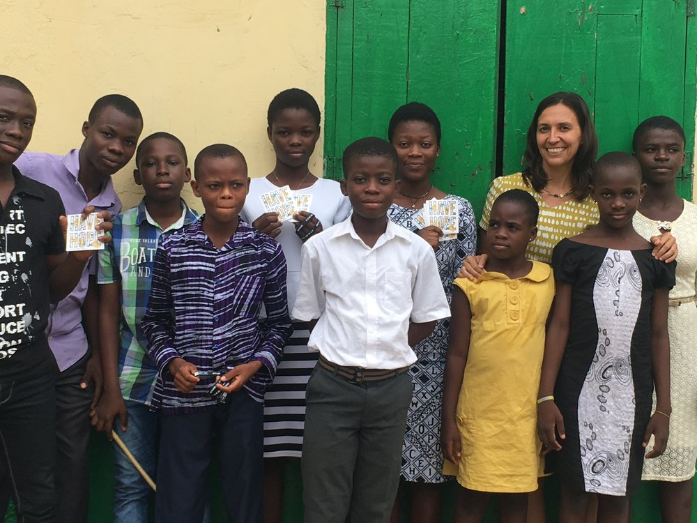 After speaking at a church service in Ghana, Nancy handed out some HFTD swag. Photo: Nancy Bartosz
