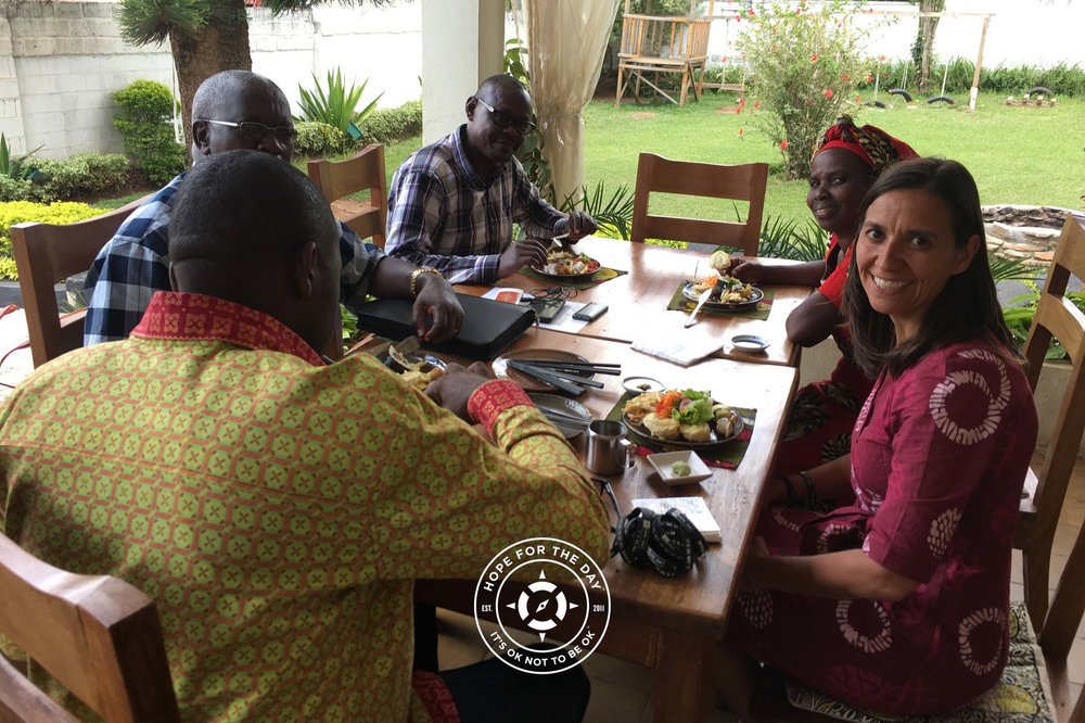 An enlightening and emotional lunch with a few of the Rwandan Rescuers. Photo: Nancy Bartosz