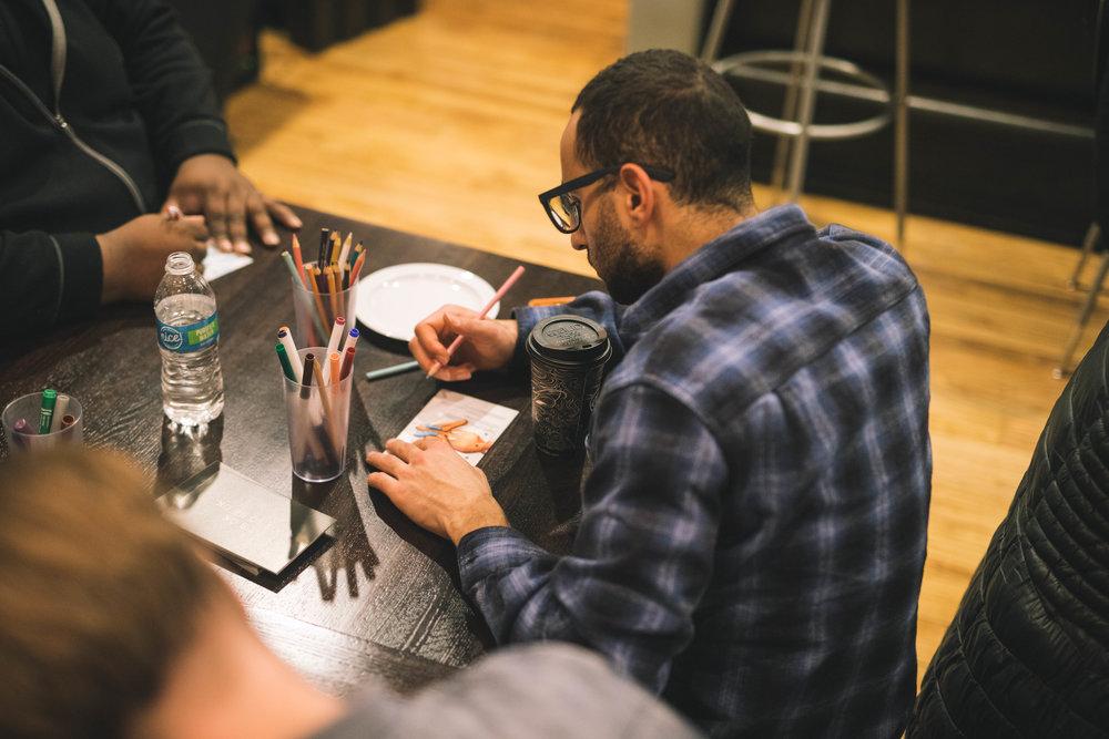 "Myron Labon, drawing his signature ""uplift"" figure. Photo: Kris Lori"