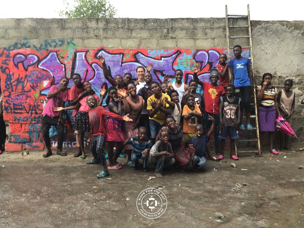 Group photo with of a Hope mural in Lusaka, Zambia. Photo: Nancy Bartosz