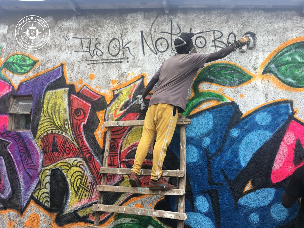 Painting a Hope mural during the Afri-Cans event in Uganda. Photo: Nancy Bartosz