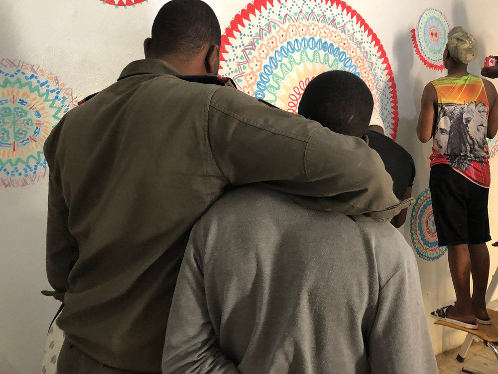 A guard and some of the boys painting the prison's learning center.. Photo: Nancy Bartosz