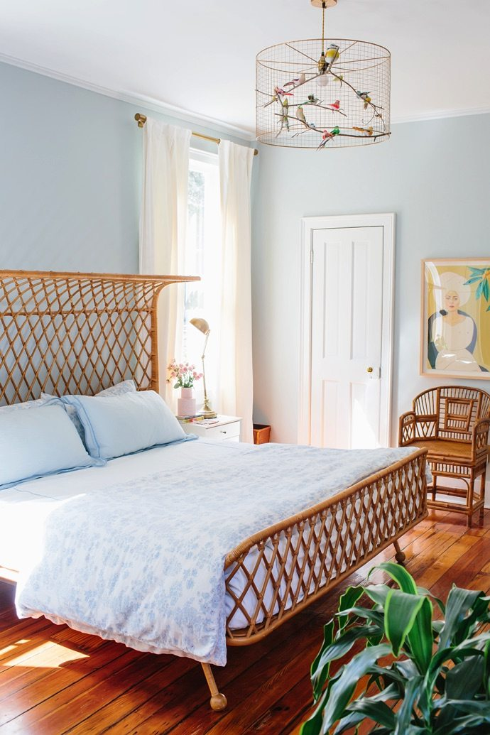 Via  My Scandinavian Home   Because the wood brings in natural elements while erring on the orangey side, and when paired with a powder blue the two work together cohesively. The ornate nature of the bed frame and armchair add a global flare, and whimsical artwork and lighting effortlessly incorporate additional accent colours and interest ☝🏼