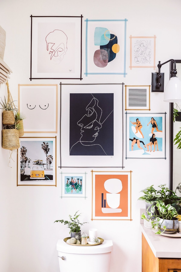 Via  HonestlyWTF   This unexpected bathroom gallery uses fun prints and washi tape to create a  framed effect  ☝🏼