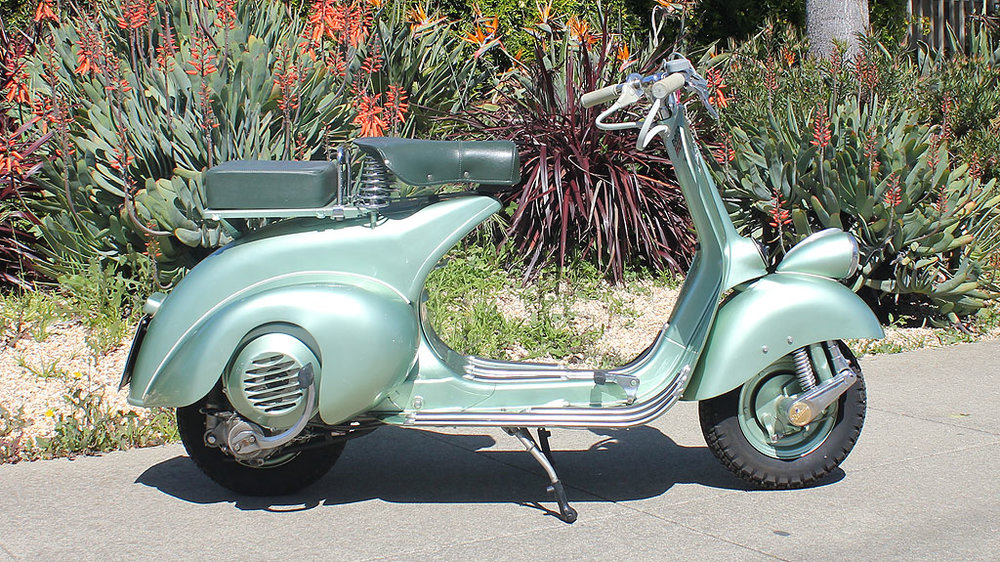 "1951 VESPA FARO BASSO (IC-132) - The early faro basso scooters are just beautiful, and this one is no exception. Look no further for the iconic ""Roman Holiday"" style.This is certainly a scooter for the serious collector."