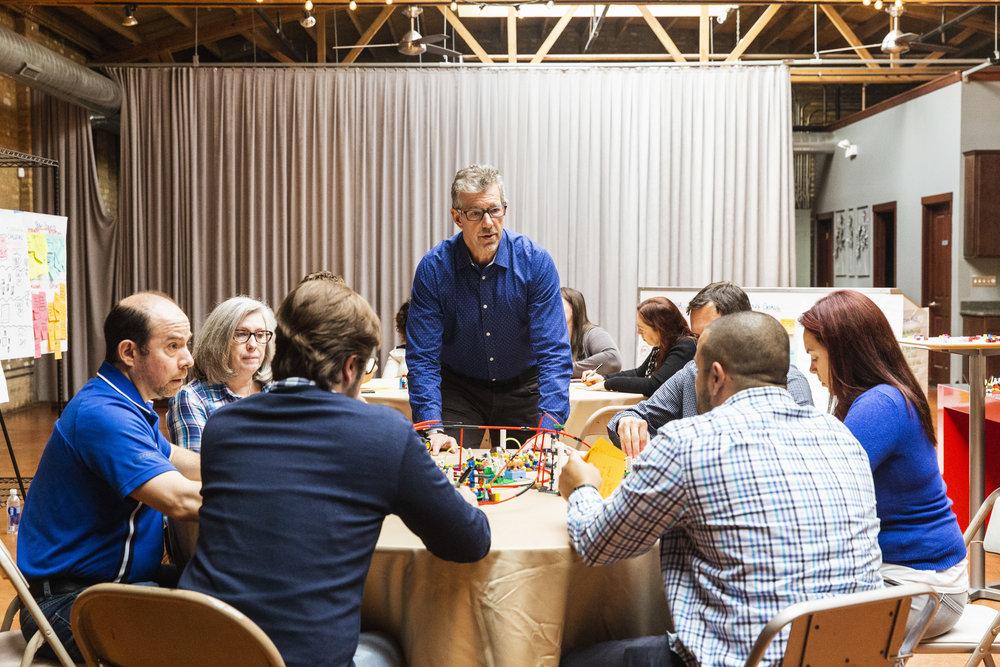 Greg facilitating a table.jpg