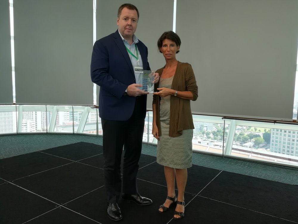 "James with GFA Director Roxane Desmicht    ""DHL Supply Chain Thailand Transport are very proud to be working in partnership with Green Freight Asia. It is an honor and a privilege to be the first business in APAC to receive this prestigious award. It tells us we are making a difference to our environment and supports our global business target to be zero emissions by 2050. I'm delighted to say the Thailand Transport team are working on new and exciting initiatives to help further improve our emissions in 2019.""    - James Macleerie, Transport Head for Thailand, Vietnam, Cambodia and Myanmar"