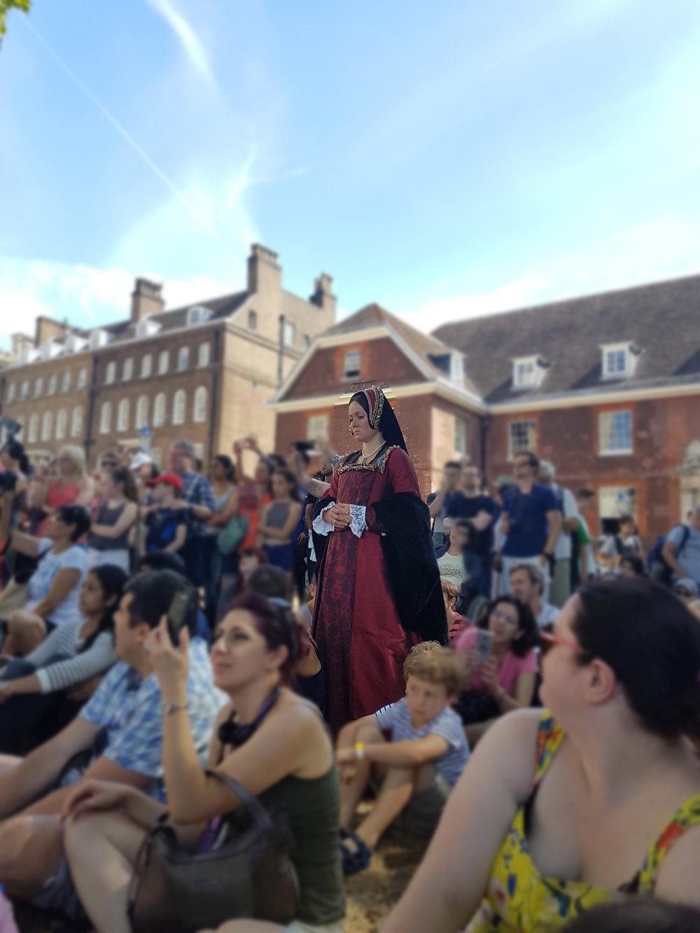 Anne Boleyn emerging from amongst the crowds