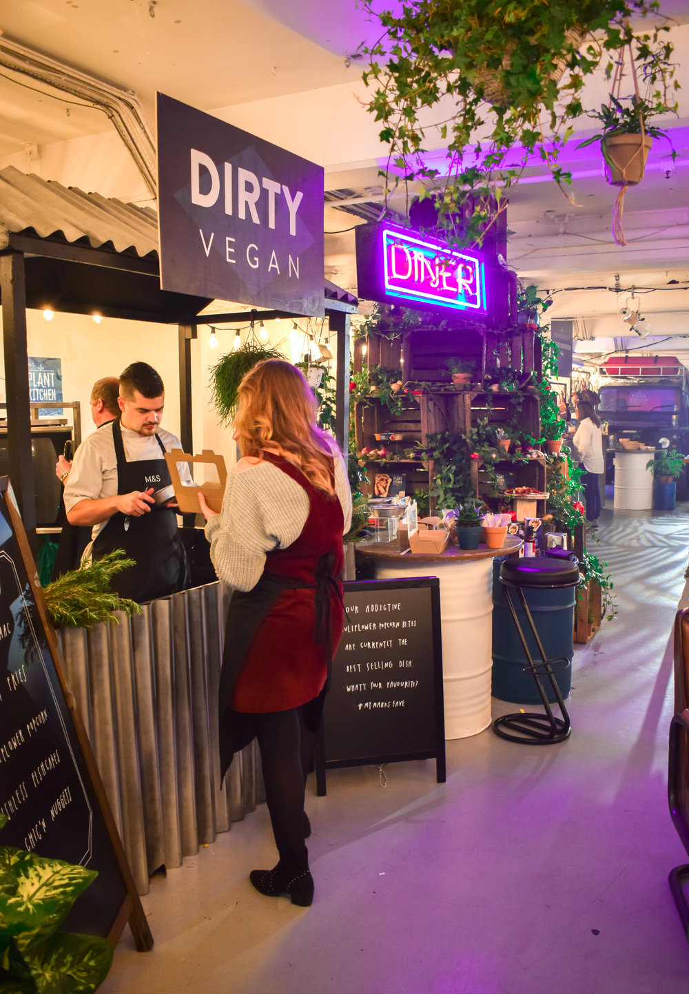 The Dirty Vegan food stand at the event of a busy event