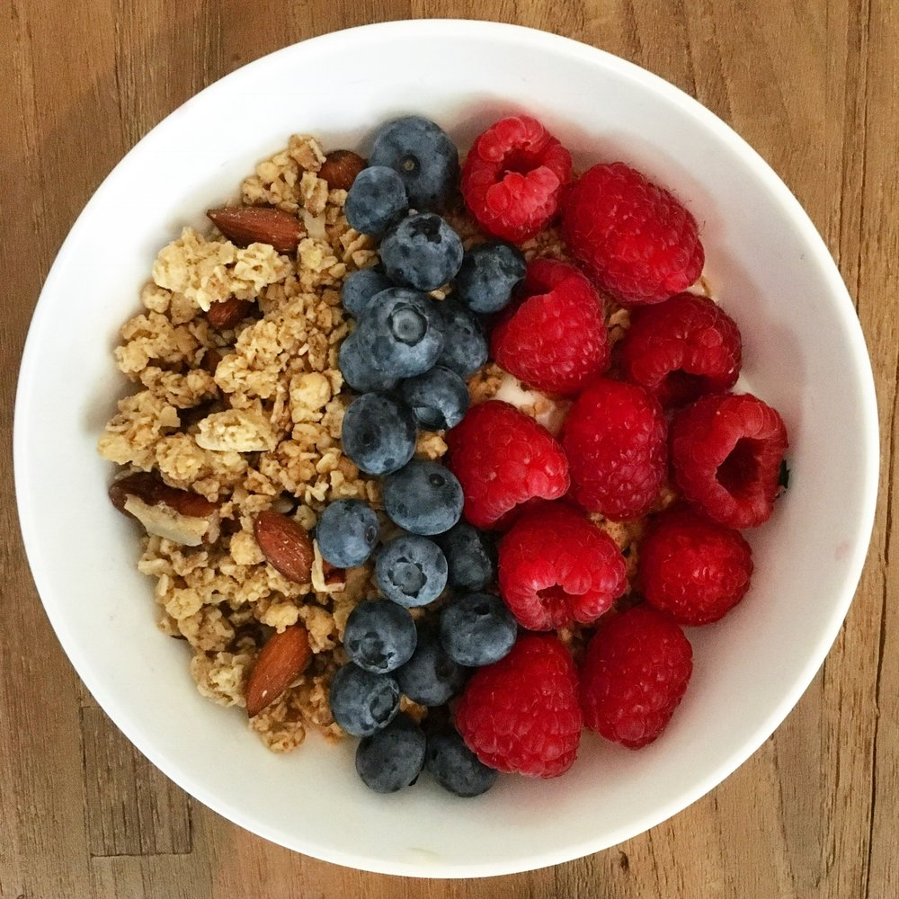 Icelandic skyr yoghurt with granola and fresh fruit - a lighter option that is still healthy and well balanced. Hint - make sure you pick a granola that is low in sugar!