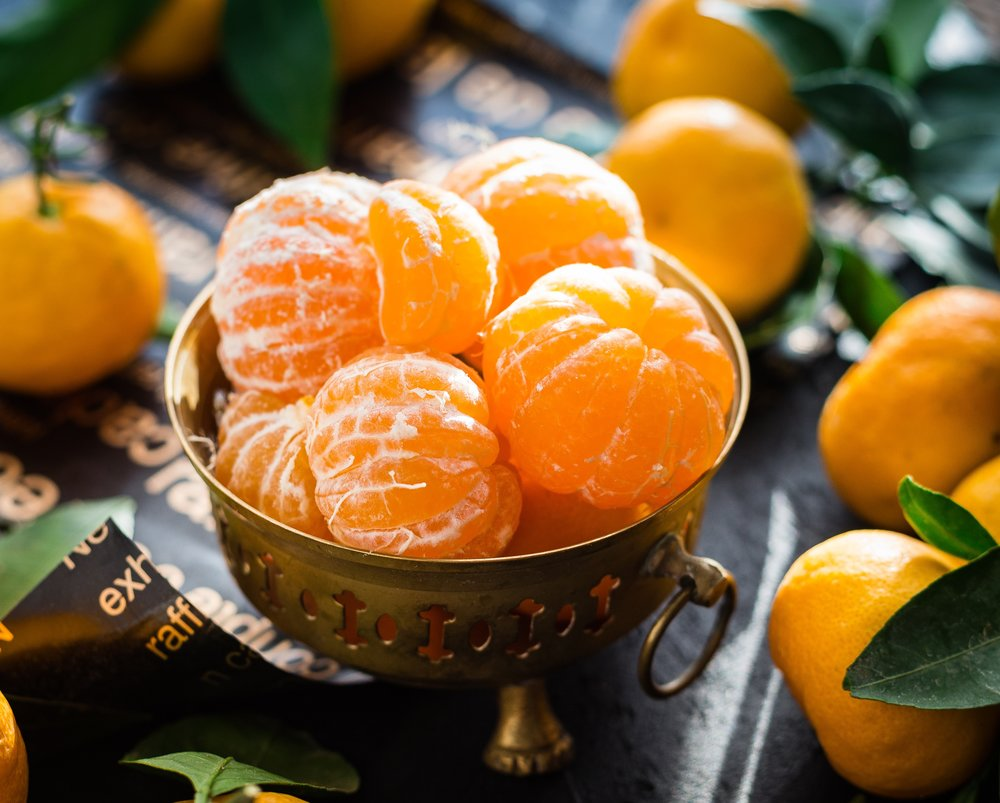 Mandarins in bowl on table