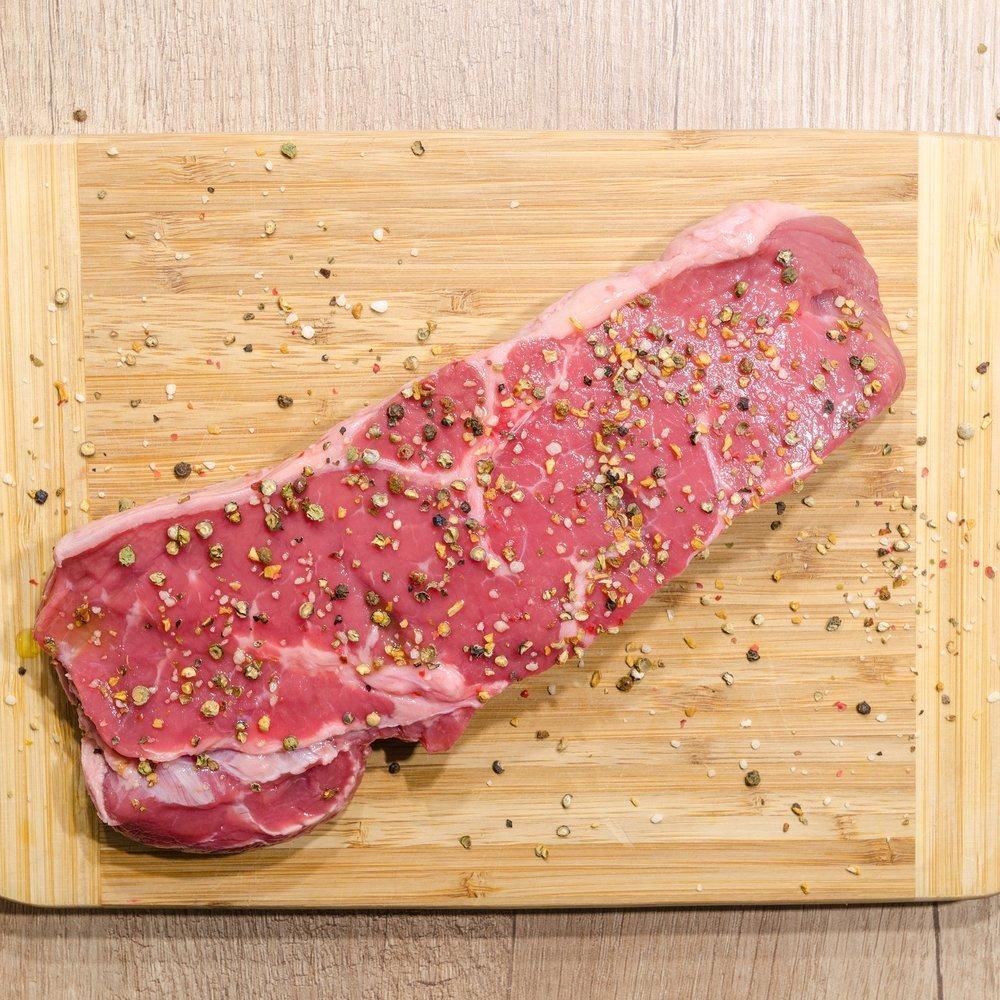 Steak on wooden chopping board