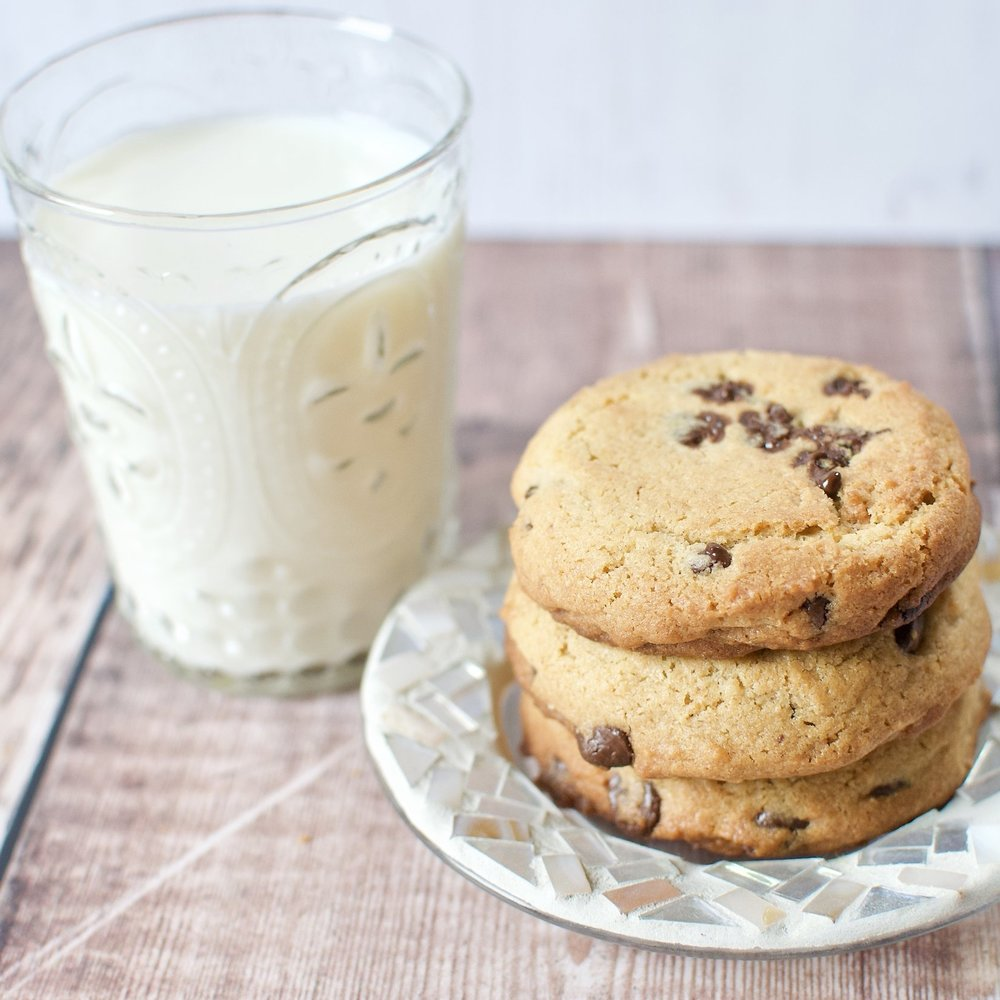 A glass of milk is a guaranteed way to get plenty of calcium! Pictured with my  PB & choc chip cookies .
