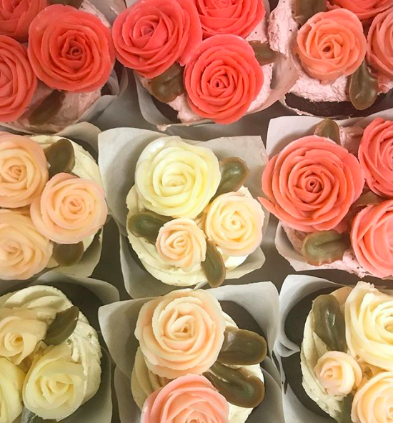 Variety of flower cupcakes