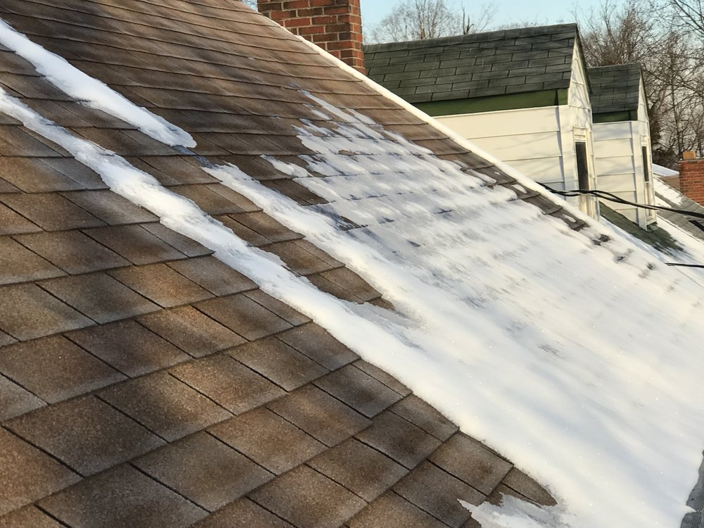 Snow melting above the gutters