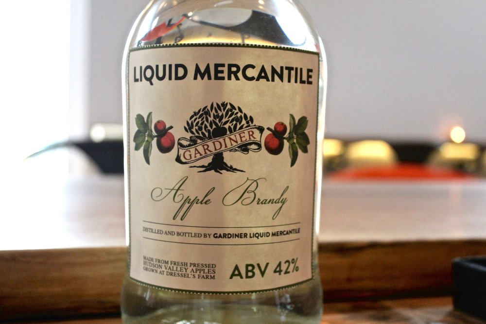 GARDINER LIQUID MERCANTILE - Gable Erenzo is former Chief Distiller at New York's Pioneering Tuthilltown Spirits Distillery. Partnering with a local 4th generation orchard, GLM brings the focus on estate spirits from the bounty of the Gardiner and New Paltz area. Gardiner Liquid Mercantile is a nano-distillery with a satellite retail shop and tasting room on Main Street in Gardiner. This Main Street Farm Shop, Cafe and Bar has become a hub for all Farm beverages and food produced within 20 miles of Gardiner Village.Find GLM at the Market Grounds on the Craft Market Walk!