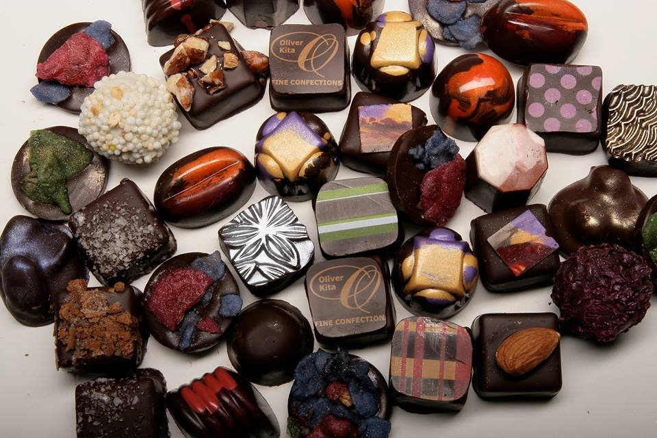 OLIVER KITA CHOCOLATES - Having a passion for cooking and baking with the perfumes and flavors of chocolate, flowers, herbs, citrus, exotic fruits, berries, nuts, and spices over the last 20 years, Chef Oliver Kita turned his time and focus to studying and training with the top master chocolatiers on two continents. The result is the Oliver Kita line of artisan fine chocolates. Only the most local and fair trade sources are complemented by traditional French methods and the finest ingredients are used. Heavy satin cream, award-winning sweet butter, the finest fruits, low sugar, and carefully selected and roasted nuts are all in an artfully hand-crafted design by Kita.