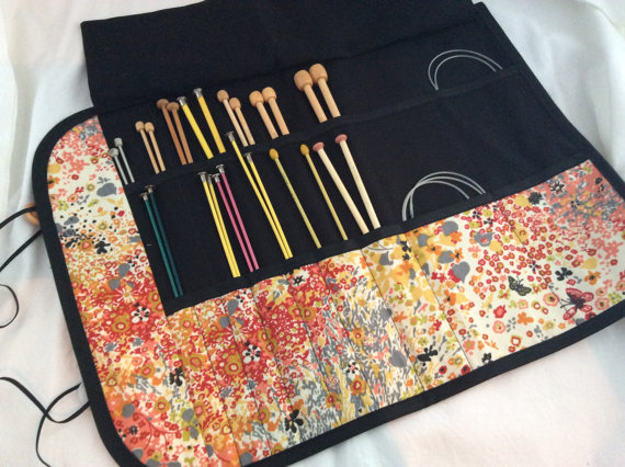CRIPPEN WORKS - Crippen Works designs elegant needle cases made with vintage buttons and fabric remnants. All fabrics are limited runs, so many pieces are one of a kind! Snatch up your favorite pattern before it's all gone! Looking for a gift for a knitter in your life? The Travel Knitting case is perfect, holding a little bit of everything.