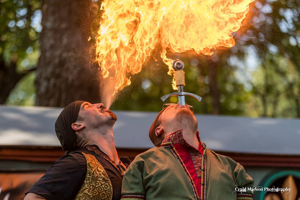 On Sept. 3, 2017, Mikhail of the Fandazzi Fire Circus (left) blew a fireball off a flaming sword swallowed by Kazimir (right).