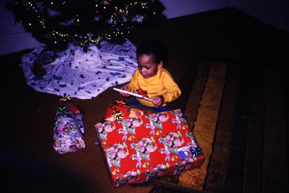 "Two-Year-Old ""Mainey"" chooses to open the present that looks like a book first."