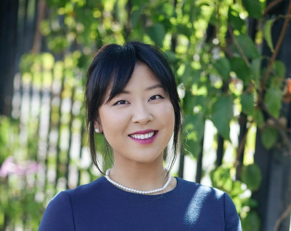 """Gina Kim ·  Maid of Honor   The first conscious memory I have of my sister was of her crying on the other side of the door of my preschool room. She was begging to join preschool to be with me - looking back at that memory, I remember a sense of feeling concerned and also thinking, """"Just give her what she wants, people!"""" Mom told me she ended up taking preschool with me.  But, Jeanne quickly became a vibrant and independent girl. We ended up going to the same school through college, so I never experienced missing her until she lived abroad. In hindsight, I think we actually had more quality conversations with Jeanne being abroad than all our years before. When she returned to the states, it was evident that our sisterhood transformed into a deeper bond. She became my pillar and was a picture of Jesus through one of the most formative seasons in my life."""