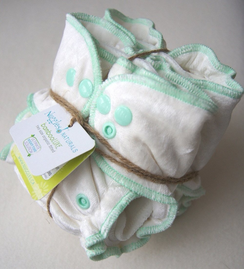 🍁  Nuggles Designs    Two Mothers stocks Nuggles fitted diapers, newborn diaper sets, size 1 and 2 covers as well as swim diapers (which can be laundered with the rest of your swimming laundry).
