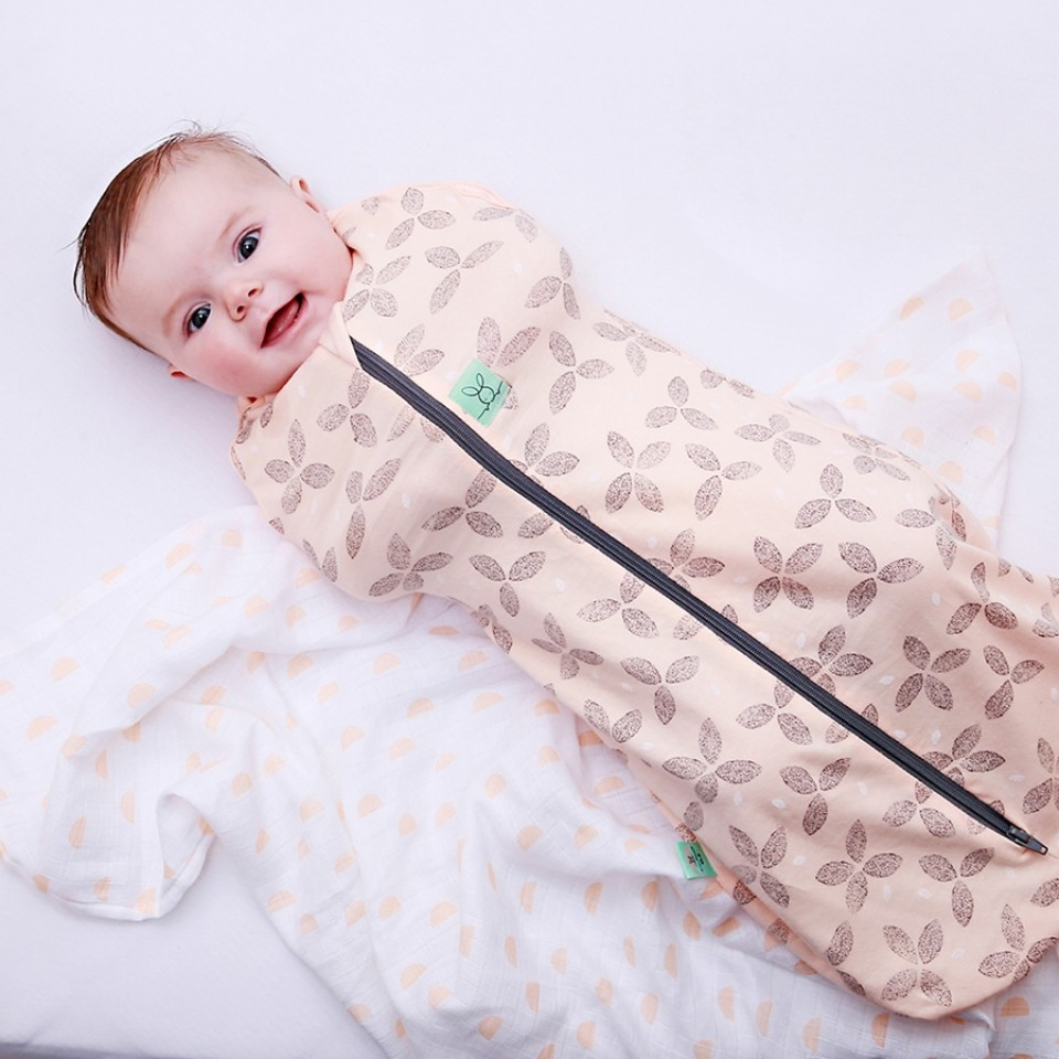 ErgoPouch    Made from breathable natural fibres, these sleep sack/swaddle hybrids allow for your baby to transition as the pouch transforms with just a couple snaps! Baby's arms and hips are not pinned inside but are kept comfortable and secure in one easy zip! The two-way zipper also allows for easy diaper changes with minimal disturbance to baby's layers. We carry them in 0-3months & 3-12months.
