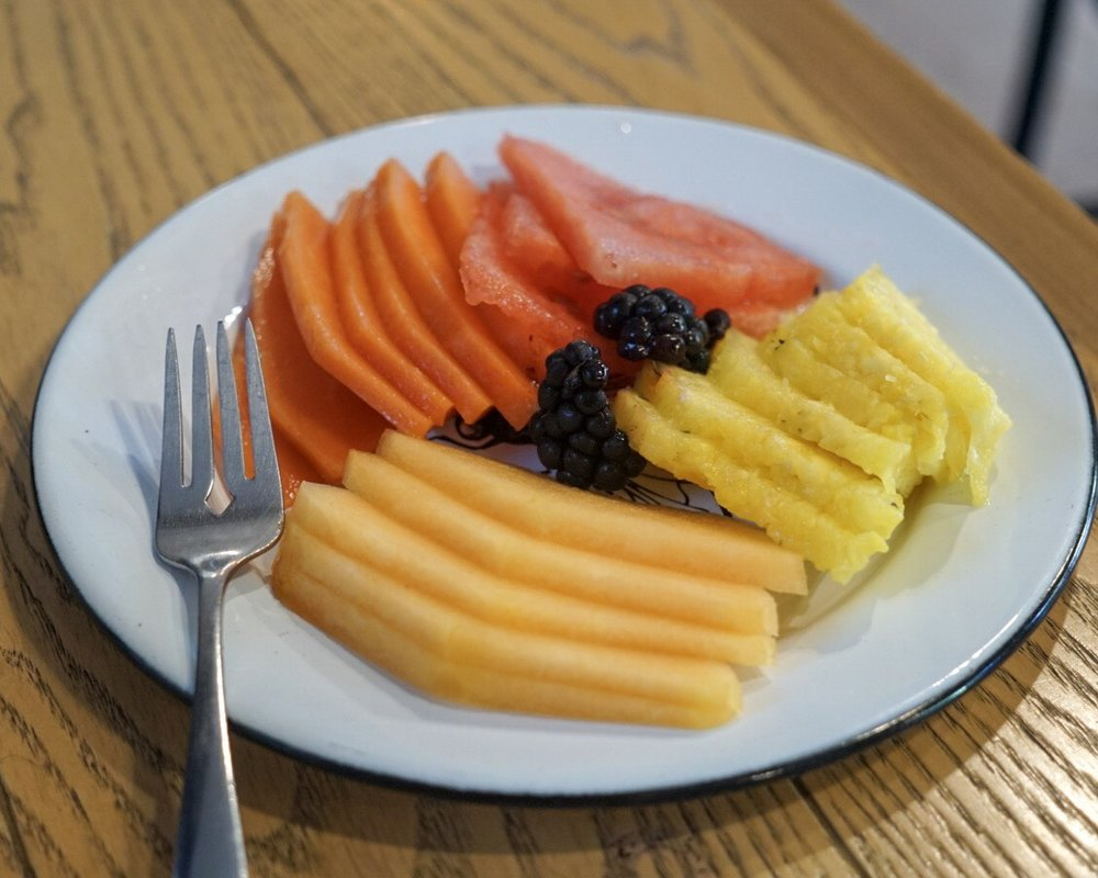 6. That orange fruit is papaya! Every time we ordered breakfast I tried to get my serving of fruit in by ordering a fruit place. They were so good...but be prepared for a lot of papaya. Once I ordered and basically received a whole plate of papaya. I would say that this fruit is an acquired taste, but not bad! Just a little different. Kind of like mushy cantaloupe.
