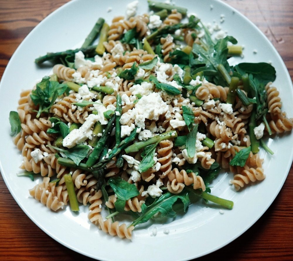 Homemade pasta with asparagus, arugula, and feta cheese
