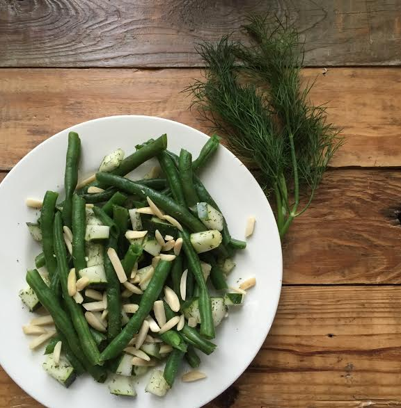 Lemony dilled green beans with cucumbers & almonds - Your garden is sprouting with more green beans than you can handle! Quick cook those suckers, toss in a little dill and some cool cukes and WOW!