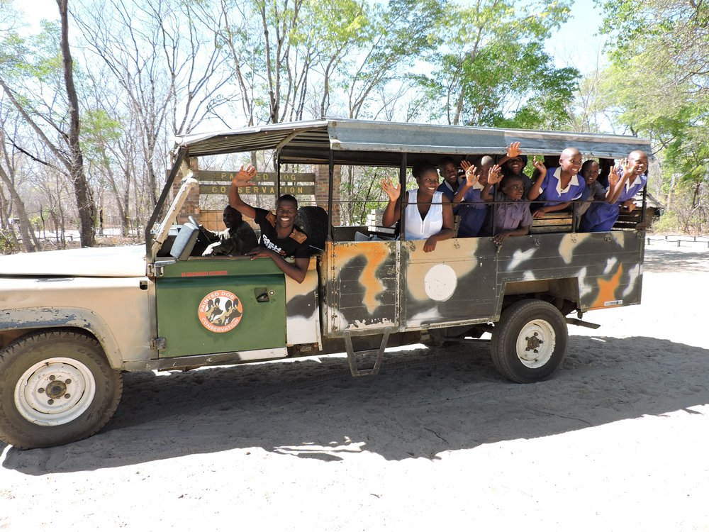Mpindo Primary School kids going on a game-drive during their stay at Iganyana CHildren's Bush Camp