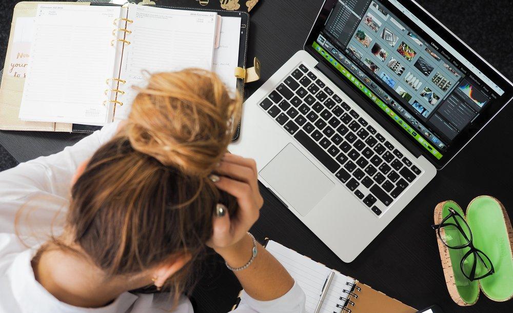 stressed woman at desk.jpg