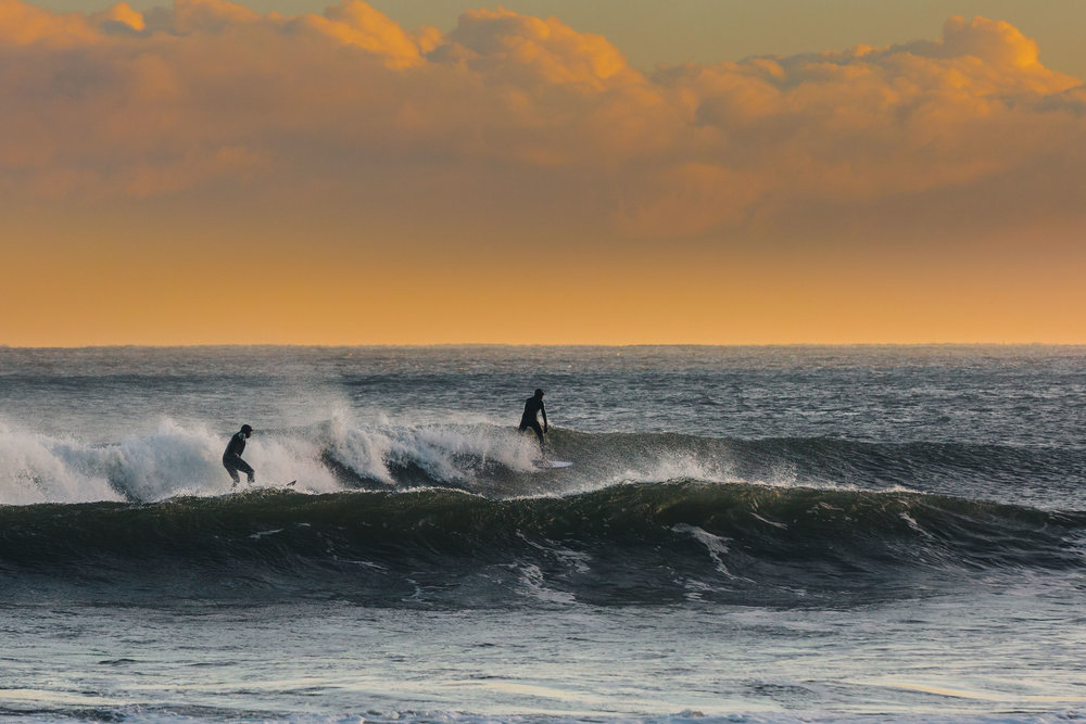 What this shot lacks in quality of surf and surfing, it makes up for in mood!