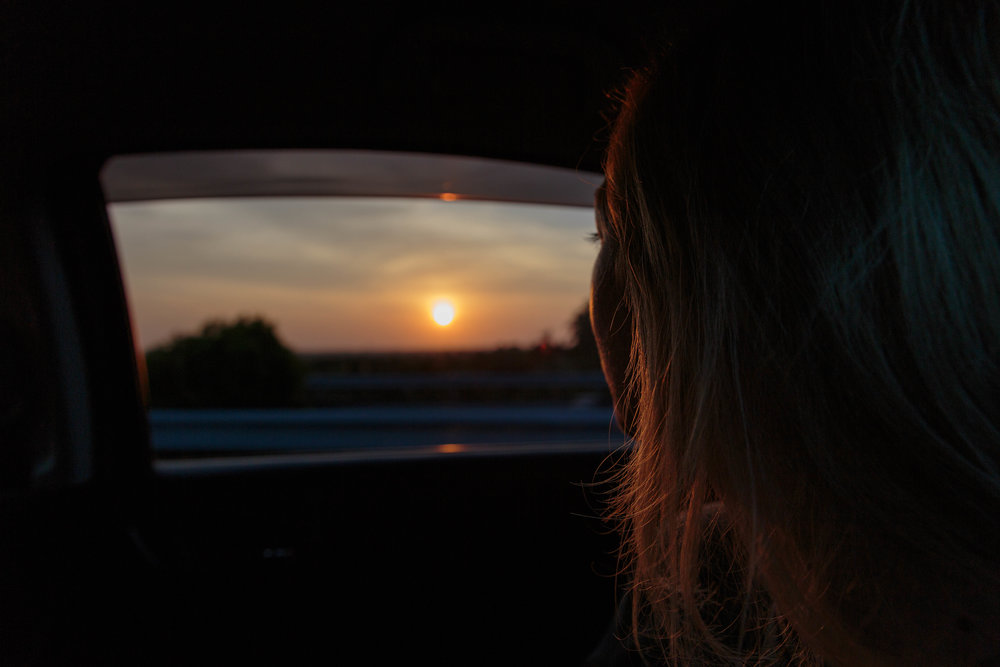 Amy admiring the sunset, on route to Colombo.