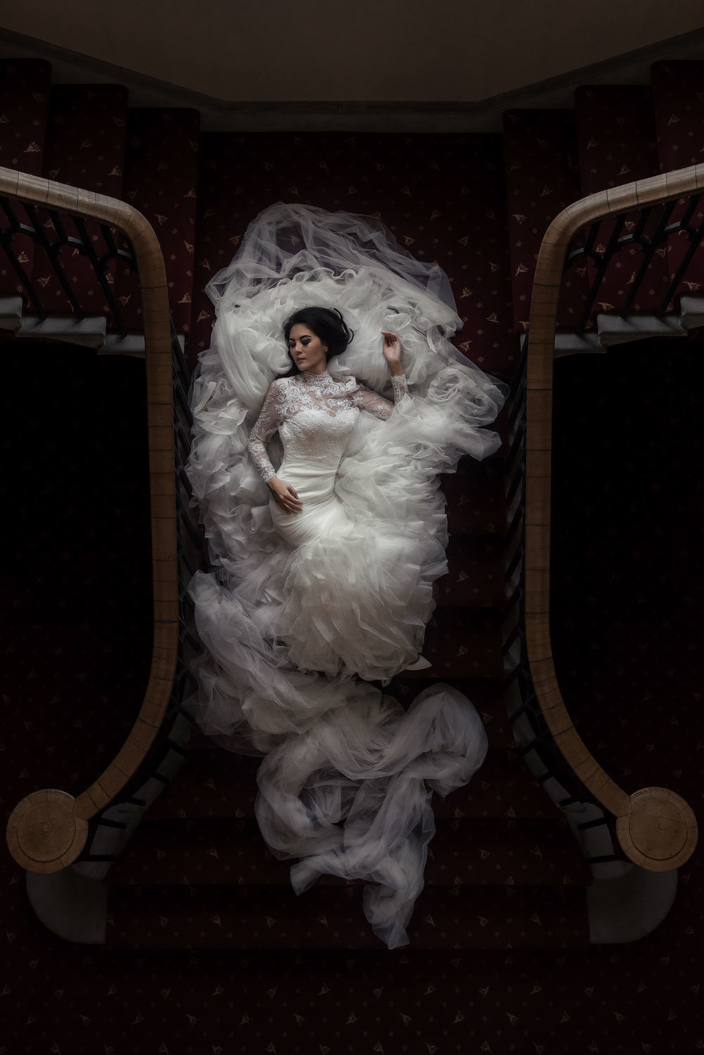 Bride laying down in window light