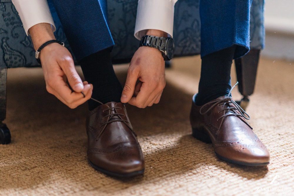 Groom tying his shoe laces