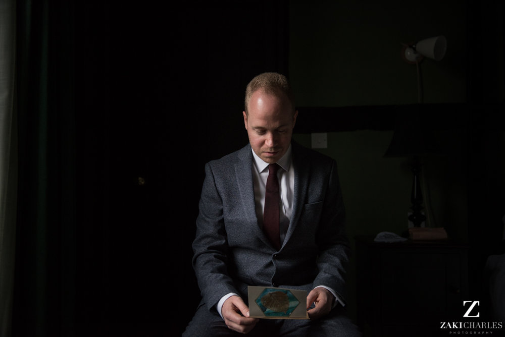 Groom reading a note from his bride
