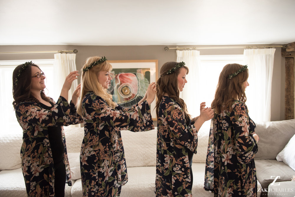 Bridesmaids getting ready in a line