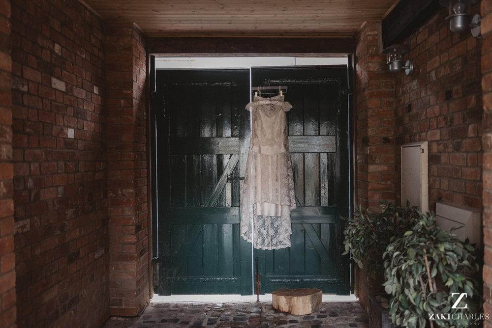 Wedding dress hanging in the sunlight