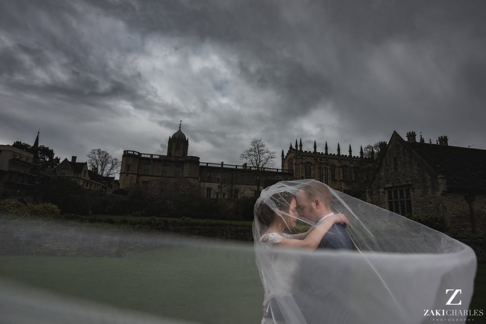 Bride and Groom portrait with veil flowing