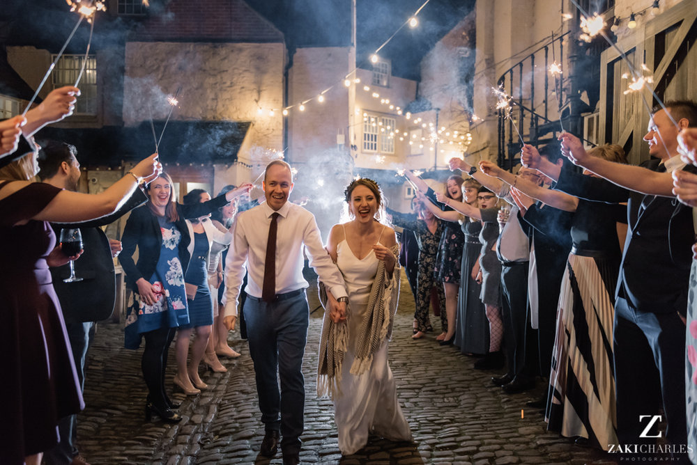 Bride and groom exit via sparklers