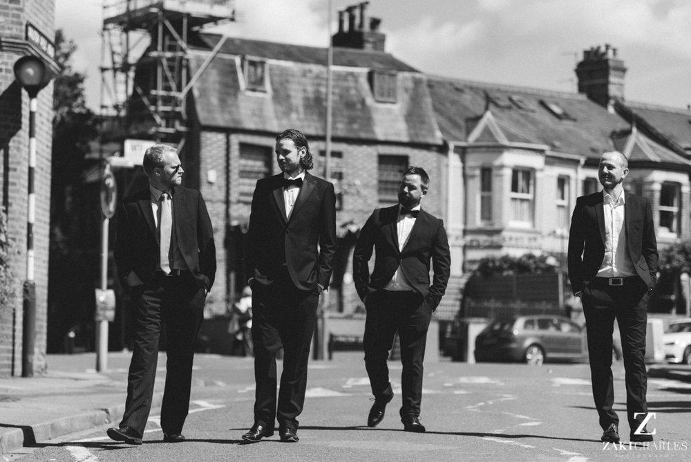 Groomsmen walking to the wedding