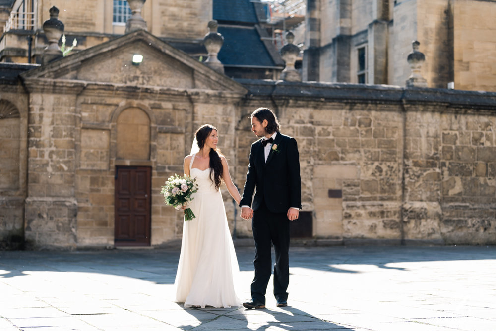 Newly wed couple walking in Oxford