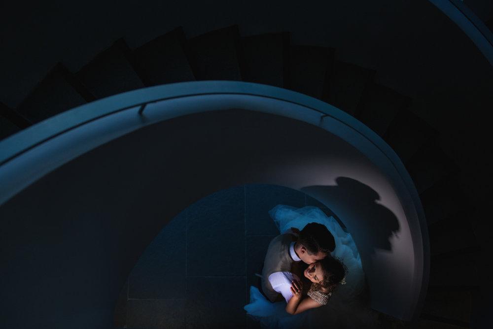 Wedding photos on a spiral staircase